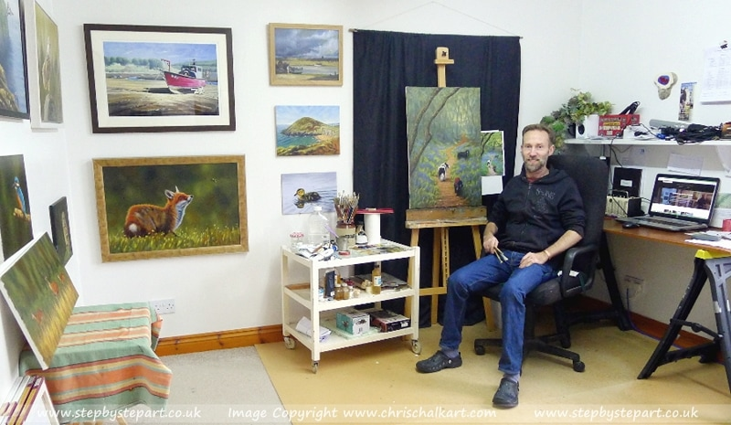 Welsh artist Chris Chalk in his studio with his vibrant Oil paintings