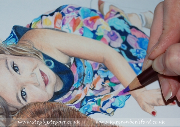 Purple Coloursoft pencil being applied to a little girls multi coloured dress pencil portrait