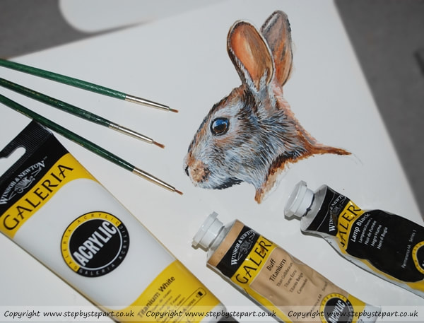 Rabbit head painting, green paintbrushes and Galeria Acrylics