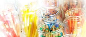 Coloured pencils in glass jar